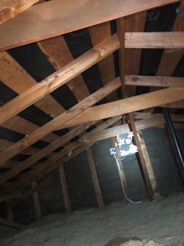Attic view of roof with skip sheathing solar suitable